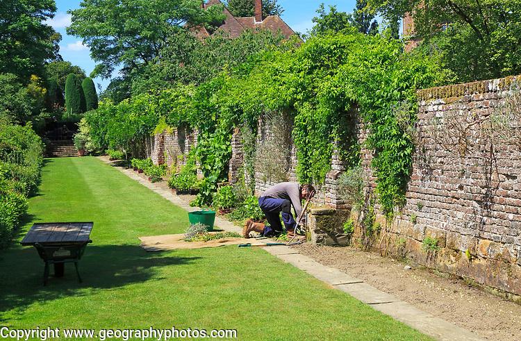 Gardener working at Sissinghurst castle gardens, Kent, England, UK