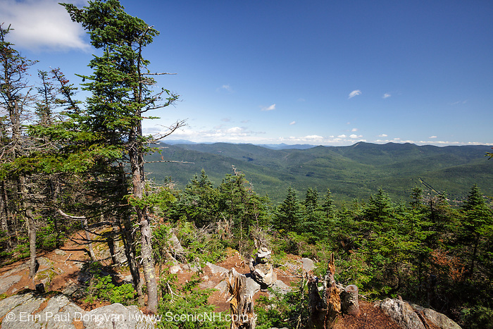 August 2013 - Scenic view from the summit of Mount Tecumseh in Waterville Valley, New Hampshire. Ongoing vandalism (tree cutting) has improved the summit viewpoint. Forest Service has stated the cutting is illegal and unauthorized.