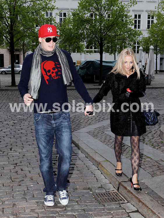 **ALL ROUND PICTURES FROM SOLARPIX.COM**.**SYNDICATION RIGHTS FOR UK AND SPAIN ONLY**.Arsenal Fc football player Nicklas Bendtner and Caroline Fleming walking to their car after spending time at Cafe Norden in Copenhagen Denmark...This pic: Nicklas Bendtner and Caroline Fleming ..JOB REF: 11267         CPR        DATE: 17.05.2010.**MUST CREDIT SOLARPIX.COM OR DOUBLE FEE WILL BE CHARGED**.**MUST NOTIFY SOLARPIX OF ONLINE USAGE**.**CALL US ON: +34 952 811 768 or LOW RATE FROM UK 0844 617 7637**