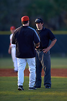 Illinois State Redbirds head coach Bo Durkac discusses a call with umpire Mike Savakinas during a game against the Ohio State Buckeyes on March 5, 2016 at North Charlotte Regional Park in Port Charlotte, Florida.  Illinois State defeated Ohio State 5-4.  (Mike Janes/Four Seam Images)