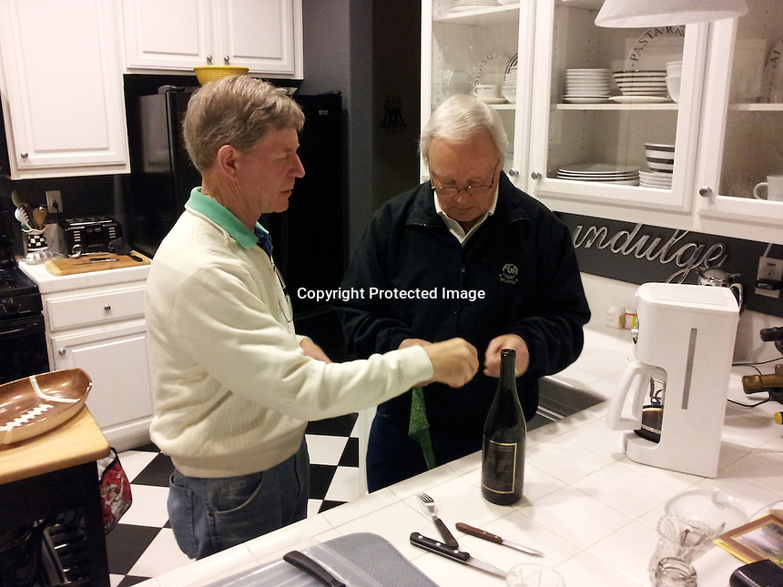 Red instructs Ron on how to open a wine bottle.