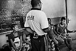 """MADAGASCAR, AMBANJA, MARCH 2013: <br />Damy Talily, Police Commissioner Ambanja, as questioning of the suspects in the death of Raddison, in the police station of Ambanja, March 2013.<br />Madagascar is home to some of the world's finest rich orange and red pods of cocoa, increasingly used today by Europe and America's finest chocolatiers.Raw cocoa beans, used to make premium chocolate, have never been in higher demand. A surge in appetite for high-end chocolate sourced from single-origin growers has created a frenzied rush for the """"dark gold"""".<br /> For the island's cocoa farmers, the surging demand for chocolate should be transformative, especially after years of poverty, but their newfound livelihoods are under threat from armed bandits running rampant in remote areas, hijacking stores and road shipments of the precious beans that make chocolate. © Giulio Di Sturco"""