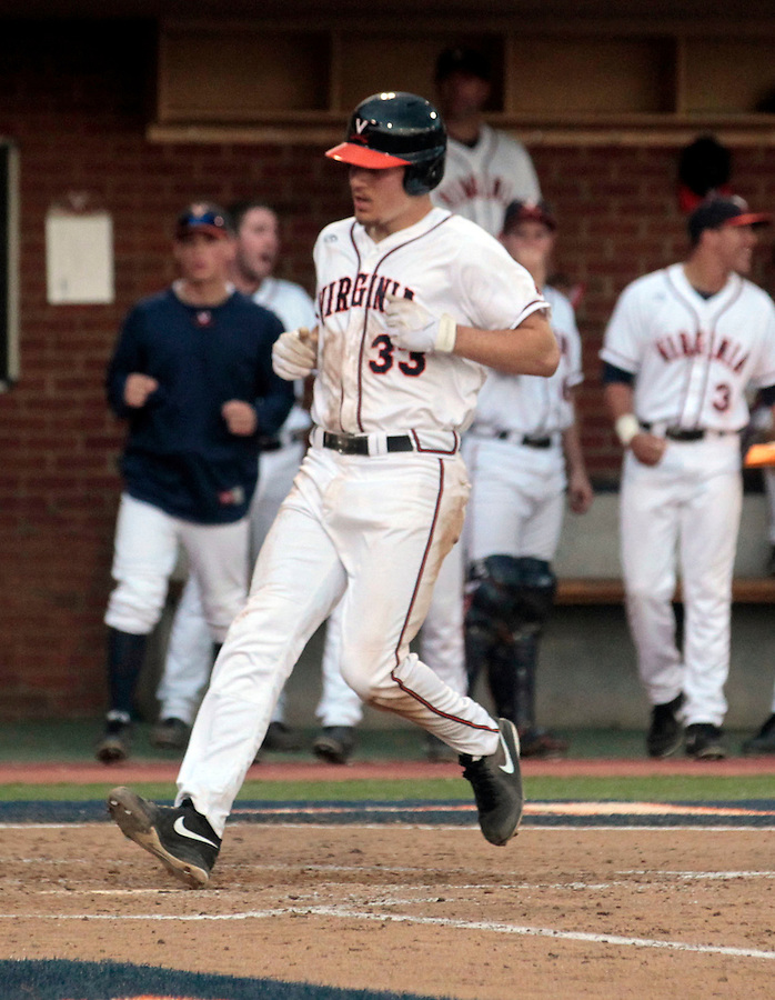 Virginia's Jacob Dean (33) scores a run during the game against Clemson Friday at Davenport Field in Charlottesville, VA. Photo/The Daily Progress/Andrew Shurtleff