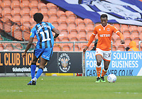 Blackpool's Marc Bola under pressure from Gillingham's Regan Charles-Cook<br /> <br /> Photographer Kevin Barnes/CameraSport<br /> <br /> The EFL Sky Bet League One - Blackpool v Gillingham - Saturday 4th May 2019 - Bloomfield Road - Blackpool<br /> <br /> World Copyright © 2019 CameraSport. All rights reserved. 43 Linden Ave. Countesthorpe. Leicester. England. LE8 5PG - Tel: +44 (0) 116 277 4147 - admin@camerasport.com - www.camerasport.com