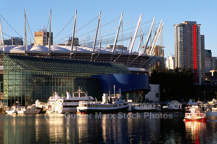 Vancouver, BC, British Columbia, Canada - BC Place Stadium (New Roof completed in 2011), and Pleasure Boats docked at False Creek - Aquabus Neighbourhood Ferry in foreground.