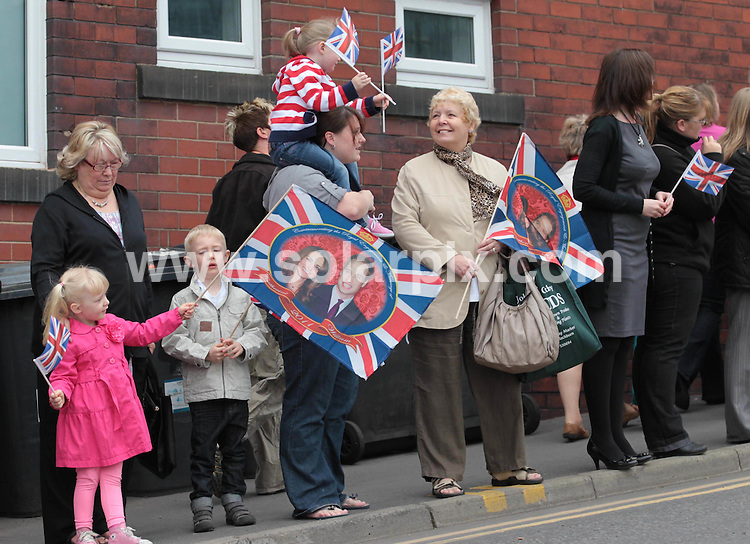 **ALL ROUND PICTURES FROM SOLARPIX.COM**                                             **NO UK NEWSPAPER PUBLICATION**.**UK MAGAZINE & SUPPLEMENT PUBLICATION ONLY** AND NO PUBLICATION IN AUSTRALIA, BELGIUM, FRANCE, GERMANY, ITALY, SCANDINAVIA AND USA**                                                                                  Caption: Royal fans greet Kate Middleton and Prince William at Darwen Aldridge Community Academy in Darwen, Blackburn for their last public engagement before their wedding. Blackburn, UK. 11 April 2011                                                                              This pic: Royal fans                                                                                       JOB REF: 13123 SFE       DATE: 11_04_2011                                                           **MUST CREDIT SOLARPIX.COM OR DOUBLE FEE WILL BE CHARGED**                                                                      **MUST AGREE FEE BEFORE ONLINE USAGE**                               **CALL US ON: +34 952 811 768 or LOW RATE FROM UK 0844 617 7637**