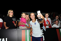 Beth Mead of England Women takes a selfie with fans at full time of the FIFA Women's World Cup Qualifier match between Wales and England at Rodney Parade on August 31, 2018 in Newport, Wales.