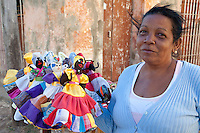 Cuba, Trinidad.  Lady with Hand-made Dolls in Handicrafts Market.