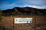 BAJA CALIFORNIA - NOVEMBER 26, 2013:  A sign at Natalia Badan's Mogor Badan vineyard  protests the mayor's relaxing of zoning regulations they say will lead to a drastic change in the culture of  the popular tourist destination.  CREDIT: Max Whittaker for The New York Times