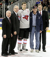 UNO senior Matt Ambroz and his father Bob Ambroz pose for a picture with UNO Associate Athletic Director Mike Kemp (left to right), UNO Chancellor John Christensen and UNO Athletic Director Trev Alberts during a ceremony honoring the team's seniors. Denver beat Nebraska-Omaha 4-2 Saturday night at Qwest Center Omaha. (Photo by Michelle Bishop).