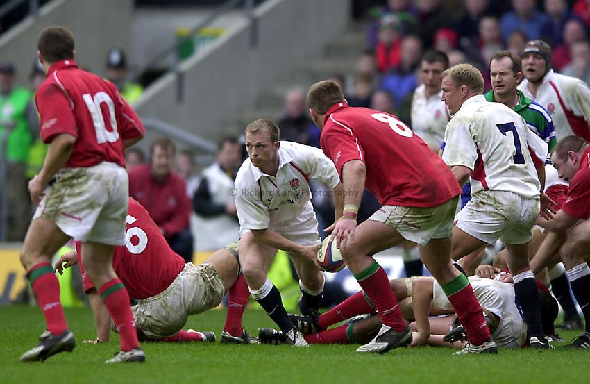 Photo. Richard Lane.Lloyds TSB Six Nations Championship. England v Wales at Twickenham. 23-3-2002.Matt Dawson gets the ball away.