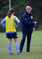 USWNT head coach Pia Sundhage talks to midfielder Kelley O'Hara during practice in Chester, PA.  The USWNT will take on China, in an international friendly at PPL Park, on October 6.