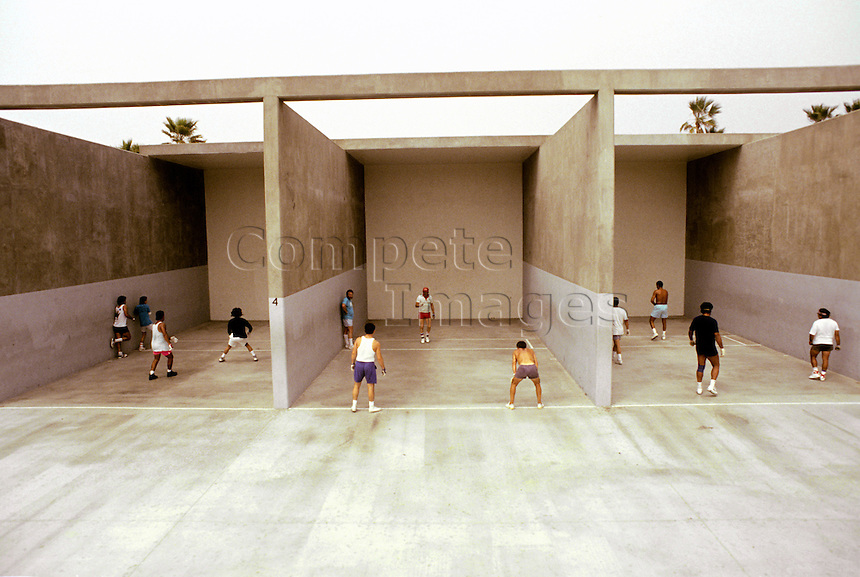 Group of three handball courts with men playing handball