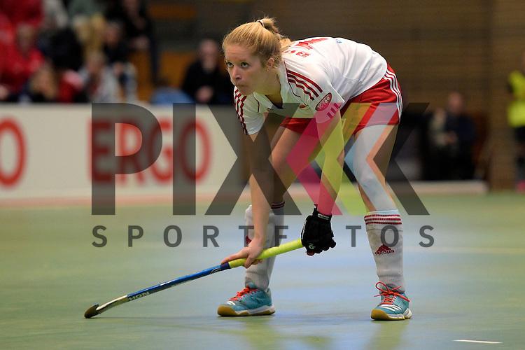 GER - Luebeck, Germany, February 06: During the 1. Bundesliga Damen indoor hockey semi final match at the Final 4 between Rot-Weiss Koeln (white) and Mannheimer HC (blue) on February 6, 2016 at Hansehalle Luebeck in Luebeck, Germany. Final score 1-2 (HT 0-2).   Julia Busch #19 of Rot-Weiss Koeln<br /> <br /> Foto &copy; PIX-Sportfotos *** Foto ist honorarpflichtig! *** Auf Anfrage in hoeherer Qualitaet/Aufloesung. Belegexemplar erbeten. Veroeffentlichung ausschliesslich fuer journalistisch-publizistische Zwecke. For editorial use only.
