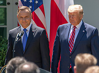 United States President Donald J. Trump, left, and President Andrzej Duda of the Republic of Poland, right, arrive to conduct a joint press conference in the Rose Garden of the White House in Washington, DC on Wednesday, June 12, 2019. <br /> Credit: Ron Sachs / CNP/AdMedia