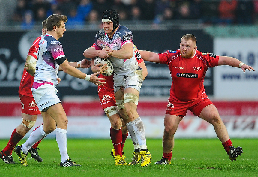Ospreys' James King is tackled by Scarlets' Jack Condy<br /> <br /> Photographer Craig Thomas/CameraSport<br /> <br /> Rugby Union - Guinness Pro12 Round 10 - Scarlets v Ospreys - Saturday 26th December 2015 - Parc y Scarlets - Llanelli<br /> <br /> &copy; CameraSport - 43 Linden Ave. Countesthorpe. Leicester. England. LE8 5PG - Tel: +44 (0) 116 277 4147 - admin@camerasport.com - www.camerasport.com