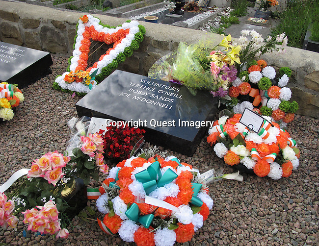 The burial plot of two of the ten  hunger strikers who died in 1981 in the H. Blocks; Bobby Sands, Joe McDonnell and Ulster Unionist Leader Terrence O&rsquo;Neill in the 'New' Republican plot at Milltown Cemetery in Belfast, Northern Ireland.  <br />
