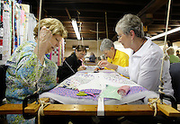 NWA Democrat-Gazette/DAVID GOTTSCHALK - 5/19/15 - Sondra Thomas (left to right), Desire' Gashler, Sharon Morgan and Eloise Gusman, quilters and members of the Rural Builders Club, an all-female group, work on baby quilts in the basement of Son's Chapel in Fayetteville before a soup lunch is served Tuesday May 19, 2015. A 75th anniversary of the dedication of the chapel with an open house is planned for May 30.