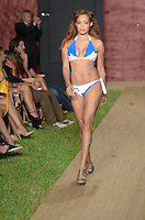 Model walks runway at Wet Couture Swimwear Show during Funkshion Fashion Week Miami Beach Swim 2013 at Miami Beach, FL on July 18, 2012