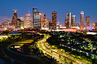 Houston Skyline After Dark - Houston Skyline after dark with the cityscape of the high rise buildings in downtown.  The Allen Parkway is well lit as the cars flow in and out of the city. From this view you can see many well know skyscrapers like the Chevron buildings, the Chase, and Heritage Plaza.
