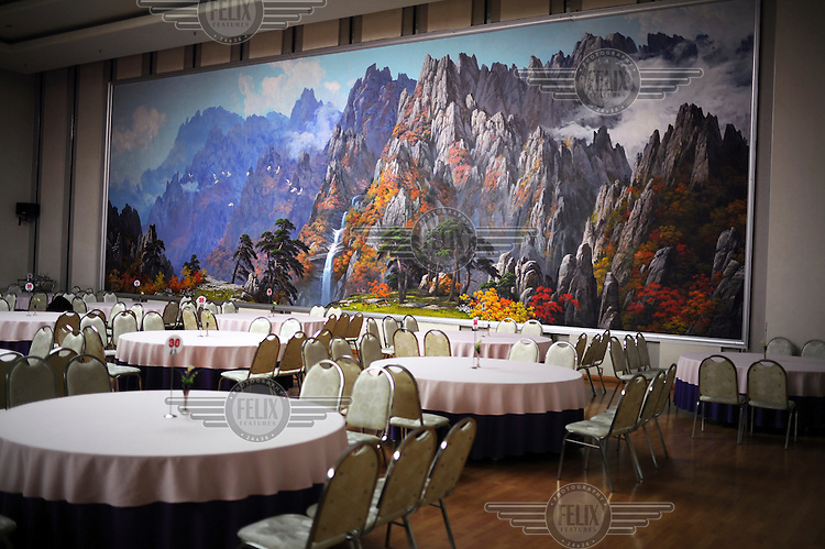 An idealised painting of North Korean mountains in the dinning  room of the Yanggakdo Hotel ......