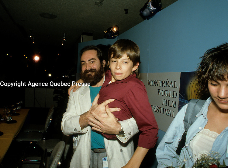 August 28, 1987 File Photo - Montreal (Qc) Canada -Kenny aka the  Kid Brother press conference t at 1987 World Film Festival.<br /> The movie directed by Claude Gagnon won the Grand-Prix des Amerique - Grand Prize of the Americas that year<br /> IN PHOTO : Claude Gagnon, Liane Curtis, , Kenny Easterday ,