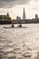 Kayaking on the River Thames in front of the Shard at sunset, London, England