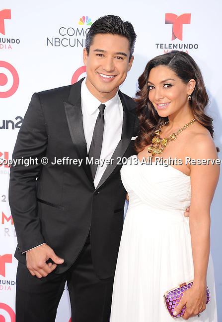 PASADENA, CA- SEPTEMBER 27: Host/TV personality Mario Lopez and actress/dancer Courtney Mazza-Lopez arrive at the 2013 NCLA ALMA Awards at Pasadena Civic Auditorium on September 27, 2013 in Pasadena, California.
