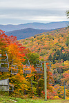 Ski lift and autumn color in the Mad River Valley, Vermont, USA