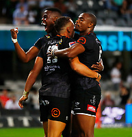 Aphelele Fassi and Makazole Mapimpi with Curwin Bosch of the Cell C Sharks after his try during the Super rugby match between the Cell C Sharks and the Emirates Lions at Jonsson Kings Park Stadium in Durban, South Africa 30 March 2019. Photo: Steve Haag / stevehaagsports.com