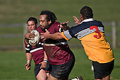 Selwyn Tuhi charges upfield past Craig Wilson. CMRFU Counties Power Cup Game of the Week between Te Kauwhata & Puni played at Te Kauwhata on Saturday May the 3rd, 2008..Te Kauwhata led 5 - 0 at halftime & went on to win 29 - 0.