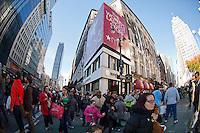 Shoppers outside Macy's in the Herald Square shopping district in New York looking for bargains on Black Friday, the day after Thanksgiving, Friday, November 25, 2011. Many retailers opened their doors on Thanksgiving or opened up for Black Friday the night before extending the shopping day into over 24 hours. (© Frances Roberts)