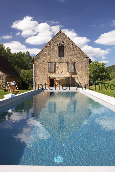 A long pool outside Le Pressoir, a 14th century mill converted into holiday lets in the grounds of the Chateau de la Bourlie in the Dordogne