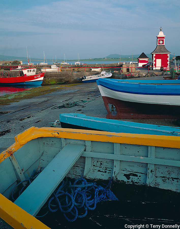 County Kerry, Ireland            <br /> Colorful wooden boats and clock tower on the Knights Town Harbor, Valencia Island, off the Iveragh Peninsula