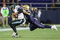Annapolis, MD - October 26, 2019: Navy Midshipmen linebacker Diego Fagot (54) tackles Tulane Green Wave quarterback Justin McMillan (12) during the game between Tulane and Navy at  Navy-Marine Corps Memorial Stadium in Annapolis, MD.   (Photo by Elliott Brown/Media Images International)