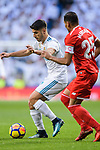 Marco Asensio of Real Madrid (L) fights for the ball with Gabriel Mercado of Sevilla FC (R) during La Liga 2017-18 match between Real Madrid and Sevilla FC at Santiago Bernabeu Stadium on 09 December 2017 in Madrid, Spain. Photo by Diego Souto / Power Sport Images