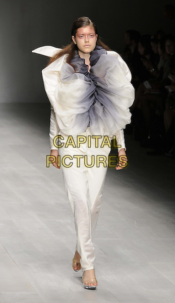 Model on runway.Corrie Nielsen s/s 2013 catwalk show, London Fashion week LFW Day 1, Courtyard Show Space, Somerset House, Strand, London, England, .14th September 2012..full length LFW modeling white black ombre top trousers .CAP/CAN.©Can Nguyen/Capital Pictures.