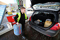 Date 15/03/2019 - SPECIAL TO GO WITH OWEN BOWCOTT STORY - Border Brexit  A petrol station attendent loads a car with refilled home heating fuel drums into a Irish regsitered car, in west Tyrone border town of Strabane. Currently Kerosene is cheaper in Northern Ireland, where locals from County Donegall travel across to buy. Photo/Paul McErlane