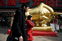 A large golden inflatable bull stands outside an electronics store in Nanjing, Jiangsu, China.  2009 is the Year of the Ox according to the Chinese lunar calendar.