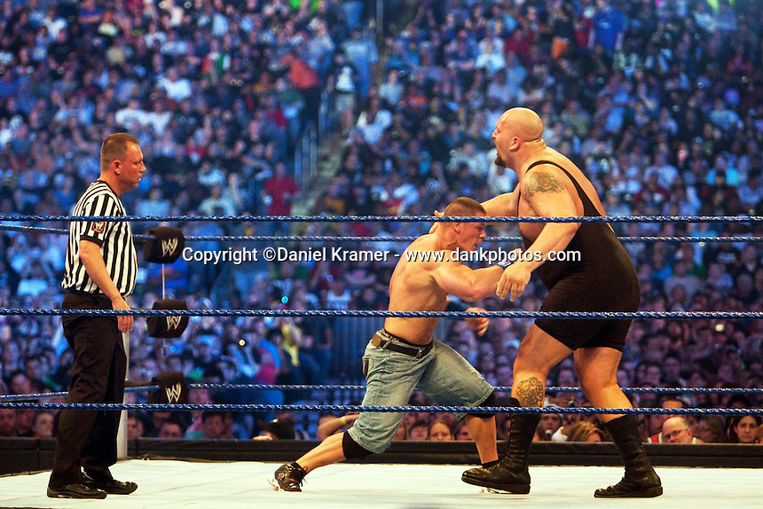 John Cena punches Big Show in the stomach in a Triple Threat match at WrestleMania 25 at Reliant Stadium on April 5, 2009 in Houston, Texas.