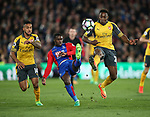 Crystal Palace's Jeffrey Schlupp tussles with Arsenal's Theo Walcott and Danny Welbeck during the Premier League match at Selhurst Park Stadium, London. Picture date: April 10th, 2017. Pic credit should read: David Klein/Sportimage