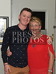 Peggy Donnelly celebrating her 80th birthday with grandcon Noel McVeigh in O'Raghallighs clubhouse. Photo:Colin Bell/pressphotos.ie