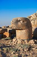 Statue head of an Eagle in front of the stone pyramid 62 BC Royal Tomb of King Antiochus I Theos of Commagene, east Terrace, Mount Nemrut or Nemrud Dagi summit, near Adıyaman, Turkey
