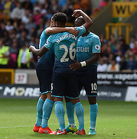 Pictured: Saturday 30 July 2016<br /> Re: Wolverhampton Wanderers v Swansea City FC, pre-season friendly at the Molineux Stadium, England, UK<br /> Kyle Naughton celebrates the Swan's second goal