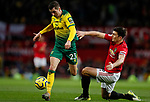 Kenny McLean of Norwich City evades Harry Maguire of Manchester United during the Premier League match at Old Trafford, Manchester. Picture date: 11th January 2020. Picture credit should read: James Wilson/Sportimage