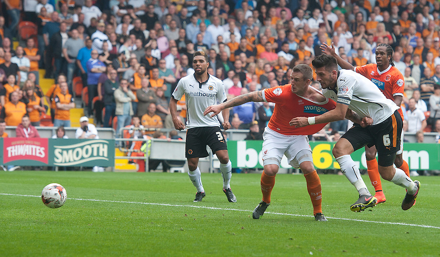 Blackpool's Peter Clarke appears to have his shirt pulled in the penalty area by Wolverhampton Wanderers' Danny Batth during sustained pressure in the first half<br /> <br /> Photographer Stephen White/CameraSport<br /> <br /> Football - The Football League Sky Bet Championship - Blackpool v Wolverhampton Wanderers - Saturday 13th September 2014 - Bloomfield Road - Blackpool<br /> <br /> &copy; CameraSport - 43 Linden Ave. Countesthorpe. Leicester. England. LE8 5PG - Tel: +44 (0) 116 277 4147 - admin@camerasport.com - www.camerasport.com
