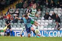 Joe Jacobson of Wycombe Wanderers falls under a challenge from Ryan Hedges of Yeovil Town during the Sky Bet League 2 match between Yeovil Town and Wycombe Wanderers at Huish Park, Yeovil, England on 8 October 2016. Photo by Mark  Hawkins / PRiME Media Images.