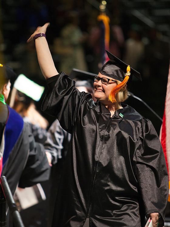 A graduate waves at Undergraduate Commencement ©Ohio University/ Photo by Kaitlin Owens
