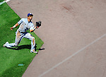 28 May 2011: San Diego Padres outfielder Eric Patterson pulls in a pop foul for an out against the Washington Nationals at Nationals Park in Washington, District of Columbia. The Padres defeated the Nationals 2-1 to even up their 3-game series. Mandatory Credit: Ed Wolfstein Photo