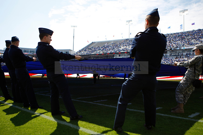 The University of Kentucky ROTC held the flag for the Star Spangled Banner before the game against Central Michigan University, in Commonwealth Stadium, on Saturday, September 10, 2011. Photo by Latara Appleby | Staff ..